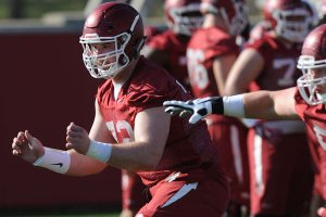 Arkansas offensive lineman Frank Ragnow moves through a drill Tuesday, March 28, 2017, during spring practice at the UA practice facility in Fayetteville.