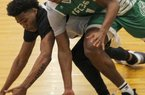 Arkansas Hawks guard Desi Sills (left) and Marcus Smart forward Kyler Edwards battle for a loose ball during the Real Deal in the Rock's 17-Under championship game Sunday at P.A.R.K. in Little Rock. Marcus Smart won the game 73-72.