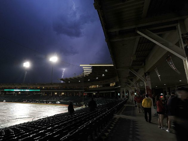 lightning-strikes-above-baum-stadium-in-fayetteville-during-a-rain-delay-in-the-arkansas-razorbacks-game-against-grand-canyon-on-tuesday-night-the-game-was-postponed-in-the-second-inning-and-will-be-completed-today-beginning-at-2-pm-as-part-of-a-doubleheader