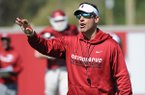 Arkansas offensive coordinator Dan Enos directs his players Saturday, April 1, 2017, during practice at the university practice field in Fayetteville.
