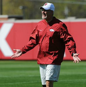 NWA Democrat-Gazette/ANDY SHUPE Arkansas defensive coordinator Paul Rhoads speaks to his players during a drill Saturday, April 1, 2017, during practice at the university practice field in Fayetteville. Visit nwadg.com/photos to see more photographs from practice.
