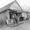 Wayne and June Martin, pictured in front of the old Mooney-Barker Drug Store in Pettigrew, were inst...