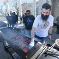 Bilal Ziada of Fayetteville grills chicken at the barbecue. Muslims believe God provides the needs o...