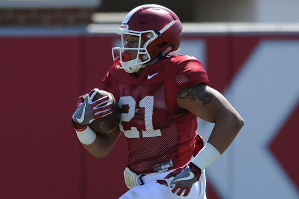 Arkansas running back Devwah Whaley carries the ball during a drill Saturday, April 1, 2017, during practice at the university practice field in Fayetteville.