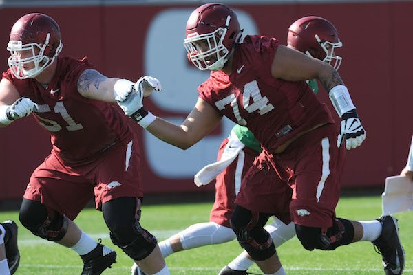 Arkansas offensive linemen Hjalte Froholdt (51) and Colton Jackson move through a drill Tuesday, March 28, 2017, during spring practice at the UA practice facility in Fayetteville.