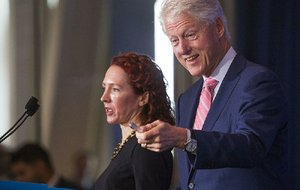 Former President Bill Clinton introduces Catherine Finn, deputy editor of Harvard Health Publications, during the Clinton Foundation's sixth annual Health Matters Activation Summit on Monday at the Clinton Presidential Center in Little Rock.
