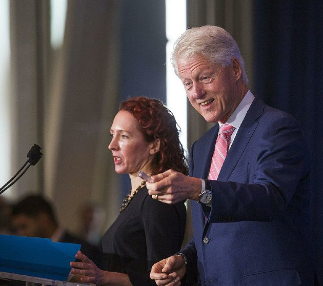 former-president-bill-clinton-introduces-catherine-finn-deputy-editor-of-harvard-health-publications-during-the-clinton-foundations-sixth-annual-health-matters-activation-summit-on-monday-at-the-clinton-presidential-center-in-little-rock
