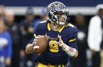 Highland Park quarterback John Stephen Jones (9) looks to pass against Temple during the first half of UIL Class 5A Division I state championship football game, Saturday, Dec. 17, 2016, in Arlington, Texas. Jones is the grandson of Dallas Cowboys owner Jerry Jones. (AP Photo/Jim Cowsert)