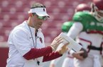 Arkansas offensive coordinator Dan Enos talks to players during a scrimmage Saturday, April 8, 2017, in Fayetteville.