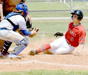 McDonald County's Tyler Stoutsenberger gets tagged out at home plate but the Mustangs still managed to come up with a 9-1win over Miami in the third place game of last week's Mickey Mantle Wood Bat Tournament in Commerce, Okla.