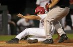 Jordan McFarland, Arkansas designated hitter, slides in to score on a wild pitch Thursday, April 13, 2017, during the third inning against Georgia at Baum Stadium in Fayetteville.