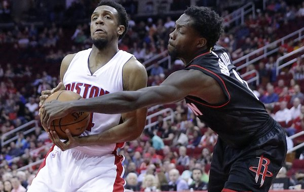 Detroit Pistons' Ish Smith (14) defends againsts the steal attempt by Houston Rockets' Patrick Beverley in the first half of an NBA basketball game Friday, April 7, 2017, in Houston. (AP Photo/Michael Wyke)