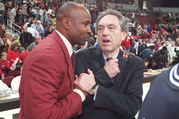 UALR coach Sidney Moncrief, left, talks with Oklahoma State coach Eddie Sutton during a game Tuesday, Nov. 23, 1999, at Alltel Arena in North Little Rock. Moncrief played for Sutton at Arkansas in the 1970s.