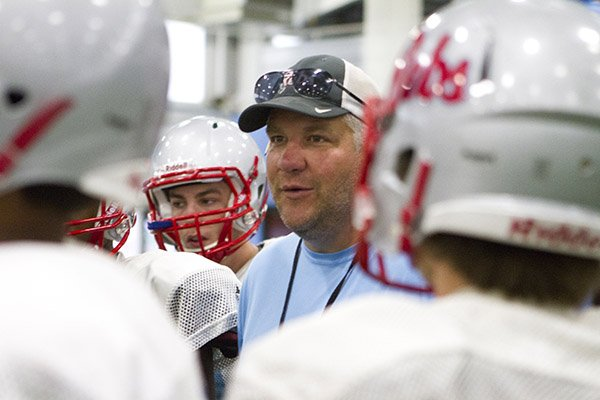 Fort Smith Southside coach Jeff Williams talks to his players prior to practice Thursday, Aug. 7, 2014.
