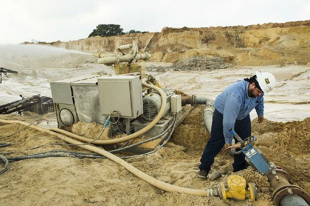 julio-griffin-adjusts-the-water-pressure-on-a-hydro-cannon-at-the-superior-silica-sands-mine-late-last-month-in-kosse-texas
