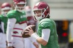 Arkansas quarterback Austin Allen goes through practice on Saturday, April 8, 2017, at Donald W. Reynolds Razorback Stadium in Fayetteville