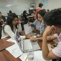 Jackie Escobar (from left), Amy Chacon and Michael Martinez work on a math problem Thursday in their...