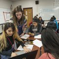 Rachel Carethers, teacher on special assignment for secondary math, helps Carolina Ulloa (from left)...