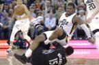"FILE - This April 7, 2017, file photo, Utah Jazz forward Joe Johnson (6) falls over Minnesota Timberwolves forward Shabazz Muhammad (15) as he tries to gain control of a loose ball during the second half in an NBA basketball game, in Salt Lake City. Johnson has been known as ""Iso Joe"" for much of his career as one of the most prolific one-on-one scorers of his generation. The 16-year veteran has grown from a high-scoring two-guard to playing power forward in one of the Jazz's best lineups. (AP Photo/Rick Bowmer, File)"