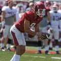 Arkansas punter Blake Johnson works during practice Saturday, August 15, 2015 at Razorback Stadium i...