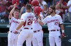 Arkansas first baseman Chad Spanberger (24) is congratulated at the plate by shortstop Jax Biggers (from left), designated hitter Evan Lee and left fielder Luke Bonfield against Georgia Saturday, April 15, 2017, after hitting a three-run home run during the second inning at Baum Stadium in Fayetteville.