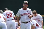 Arkansas coach Dave Van Horn walks toward the dugout prior to a game against Georgia on Saturday, April 15, 2017, in Fayetteville.