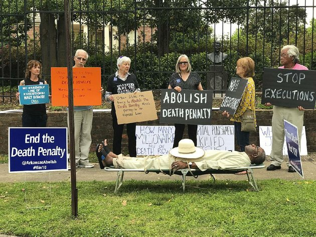 pulaski-county-circuit-judge-wendell-griffen-lies-on-a-cot-outside-the-governors-mansion-during-a-protest-against-the-death-penalty-friday-griffen-who-issued-a-restraining-order-friday-in-a-lawsuit-by-the-maker-of-one-of-the-lethal-drugs-that-would-be-used-in-the-execution-of-arkansas-inmates-has-come-under-heavy-criticism-from-death-penalty-proponents-for-taking-part-in-the-protest