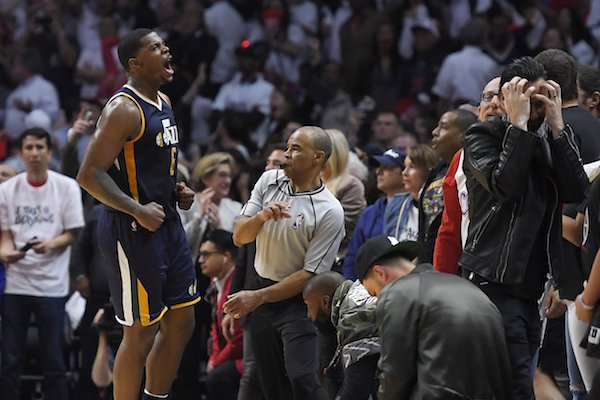 Utah Jazz forward Joe Johnson, left, celebrates after hitting the game-winning basket in Game 1 of an NBA basketball first-round playoff series against the Los Angeles Clippers, Saturday, April 15, 2017, in Los Angeles. The Jazz won 97-95. (AP Photo/Mark J. Terrill)