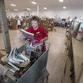 Alicia Barrett of Rogers sorts books Thursday at Rogers Samaritan Shop's new location at the old Rog...