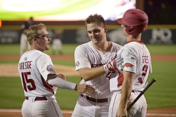 Jake Arledge (15), Arkansas right fielder, and Jared Gates (3), Arkansas third baseman, congratulate Alex Gosser, Arkansas catcher, after he hit a home run Thursday, April 13, 2017 during eighth inning against Georgia the game at Baum Stadium in Fayetteville.