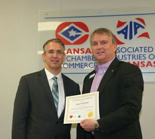 Submitted photo CONTINUING EDUCATION: Danny Games, left, vice president of global business, presented a certificate to Gary Troutman for completing the Mid-South Basic Economic Development Course.