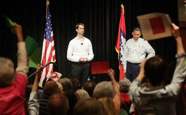 us-sen-tom-cotton-left-and-us-rep-french-hill-fi-eld-questions-from-an-audience-of-1000-people-at-a-public-meeting-monday-in-west-little-rock-some-in-the-crowd-were-angry-over-recent-actions-by-congress-and-the-president-but-other-people-expressed-support