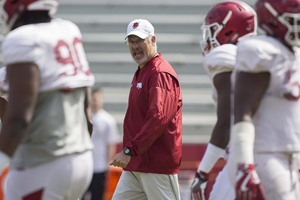 Arkansas defensive coordinator Paul Rhoads talks to players prior to a scrimmage April 8, 2017, in Fayetteville.