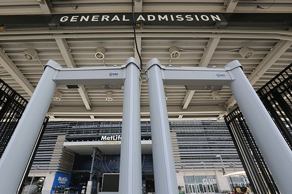 In this Thursday, May 28, 2015, photo, metal detectors stand at a gate at MetLife Stadium in East Rutherford, N.J. Beginning June 1, 2015, metal detectors were used to check people attending events at the stadium. (AP Photo/Julio Cortez)