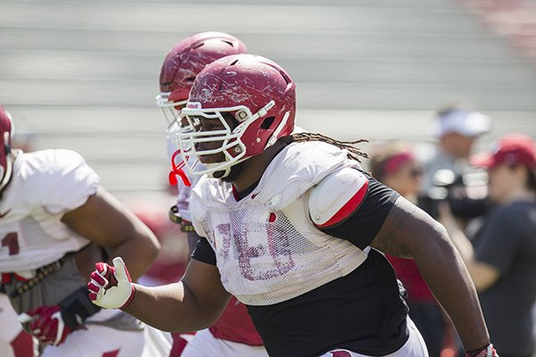 Arkansas defensive tackle Bijhon Jackson goes through warmups prior to a scrimmage Saturday, April 15, 2017, in Fayetteville.