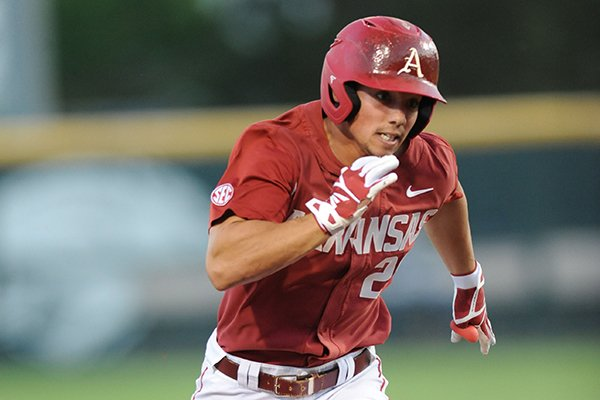 Arkansas center fielder Dominic Fletcher heads to third after hitting a three-run triple against Memphis Tuesday, April 18, 2017, during the third inning at Baum Stadium.