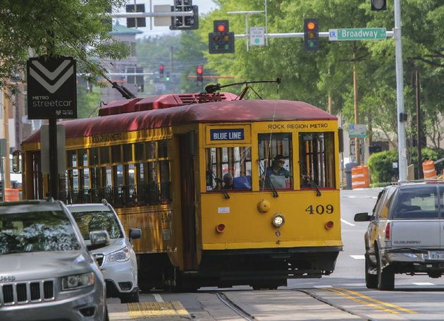 a-rock-region-metro-trolley-turns-onto-west-markham-street-from-spring-street-on-tuesday-in-downtown-little-rock