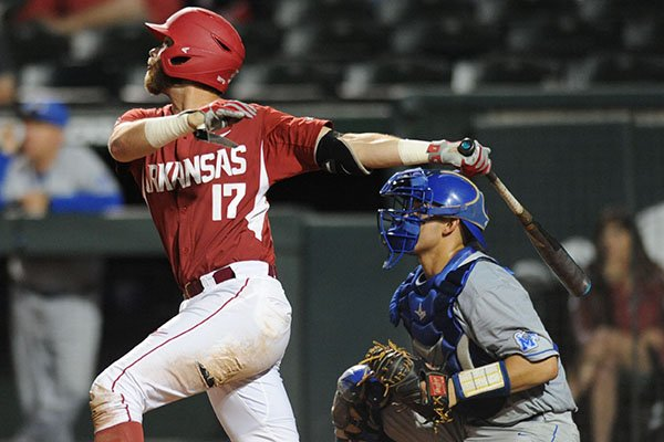 Arkansas' Luke Bonfield bats while Memphis' Jason Santana catches during a game Tuesday, April 18, 2017, in Fayetteville.