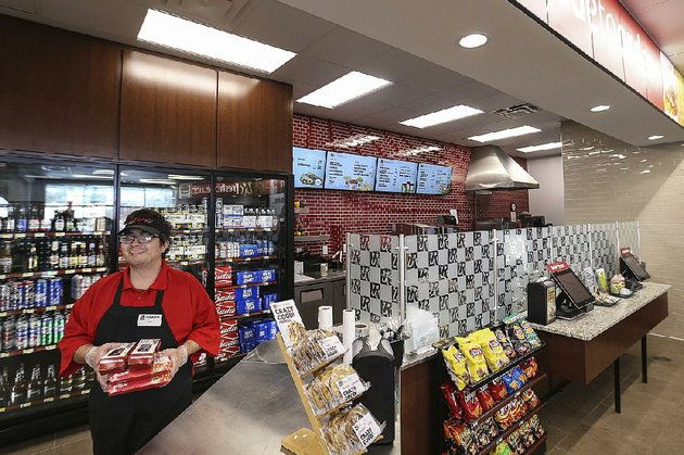 server-kirk-adams-prepares-a-food-order-at-rickers-convenience-store-in-columbus-ind-where-cold-beer-is-sold