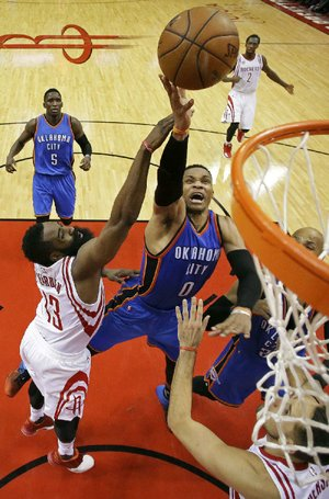 Oklahoma City guard Russell Westbrook (right) gets to the rim past Houston guard James Harden during the second half of Wednesday's game. Westbrook finished with 51 points, 13 assists and 10 rebounds, but the Rockets surged ahead in the fourth quarter to beat the Thunder 115-111 and grab a 2-0 lead in their NBA Western Conference playoff series.