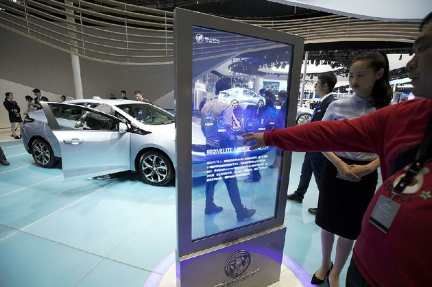 visitors-look-at-buicks-velite-5-a-rebranded-chevrolet-volt-displayed-wednesday-at-the-auto-shanghai-2017-show-at-the-national-exhibition-and-convention-center