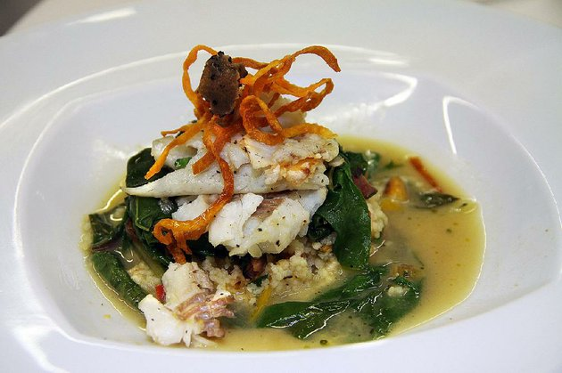 mary-beth-ringgolds-diamond-chef-winning-dish-freshwater-bass-served-over-a-melange-of-wild-mushrooms-and-spinach-nested-over-roasted-vegetable-couscous-on-a-single-leaf-of-swiss-chard-ladled-with-a-reduction-of-fish-stock-white-wine-and-parmesan-and-dotted-with-white-truffle-oil-garnished-with-crispy-sweet-potato-spirals-and-a-shaving-of-fresh-truffle