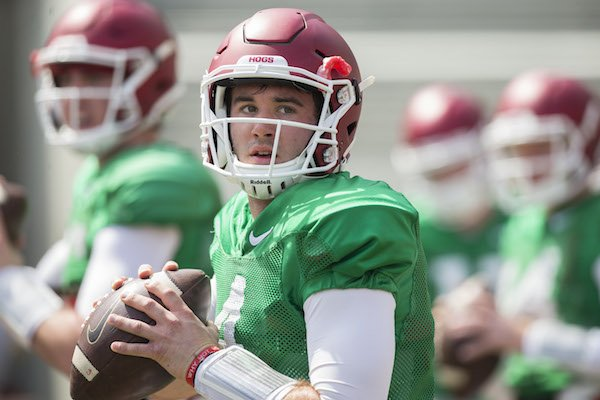 Arkansas quarterback Ty Storey warms up before the Razorbacks' first scrimmage of spring practice Saturday, April 8, 2017.