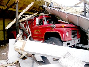 Photo submitted Firefighters with Goodman Fire Department have been working hard to dig out fire trucks buried in debris by the April 4 tornado that hit the town.