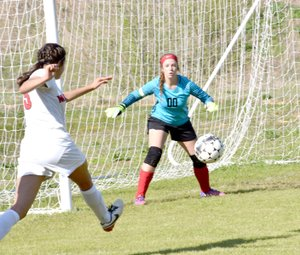 Photo by Rick Peck McDonald County's Karla Barreda shoots and scores during the Lady Mustangs' 4-2 loss on April 11 at Loyce Shellnut Soccer Field in Anderson.