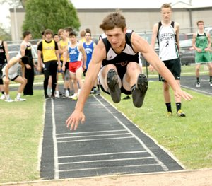 Photo by Rick Peck McDonald County freshman Jack Teague flies through the air with a leap of 18-7 in long jump to take fifth place at the East Newton Relays held April 13 at East Newton High School.