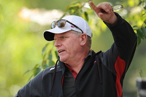 arkansas-coach-chris-bucknam-speaks-to-an-assistant-coach-saturday-oct-1-2016-during-the-28th-annual-chile-pepper-cross-country-festival-at-agri-park-in-fayetteville