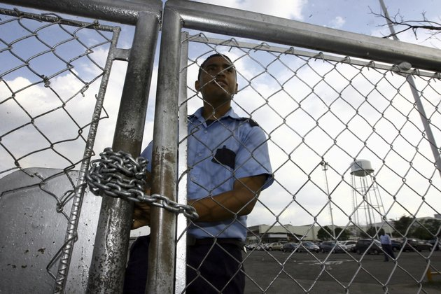 file-in-this-june-19-2009-file-photo-a-security-guard-stands-behind-a-fence-at-the-general-motors-assembly-plant-in-valencia-venezuela-general-motors-says-it-has-halted-operations-in-venezuela-after-authorities-seized-a-factory-the-plant-was-confiscated-on-wednesday-april-19-2017-in-what-gm-called-an-illegal-judicial-seizure-of-its-assets-gm-says-its-due-process-rights-were-violated-and-it-will-take-legal-steps-to-fight-the-seizure-ap-photojuan-carlos-hernandez-file