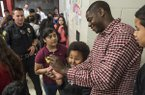 Ronnie Brewer takes photos with students at Sonora Middle School on Friday, May 15, 2015, in Springdale.