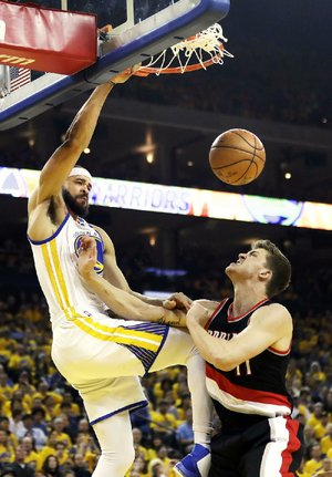 Golden State center JaVale McGee (left), stepping up several key players out for Wednesday's game against Portland, had 15 points, 5 rebounds and 4 blocked shots to help the Warriors blow past the Trail Blazers 110-81 to grab a 2-0 lead in their NBA Western Conference playoff series.
